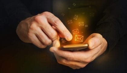 Man Holding Smartphone Email Icons_Medium__Comp