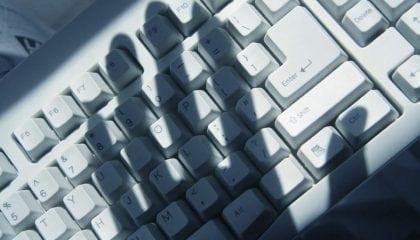 Hand Shadow on Keyboard_Medium__Comp