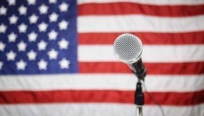 7c93014a-5e6a-48a4-a3c0-b9299a0a3ca4american_flag_with_microphone_medium__comp.jpg